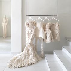 A fantasy rack of wedding weekend outfit options courtesy of Mihano Momosa Mihano Momosa, Mode Ootd, Feather Dress, Feather Art, Wedding Weekend, Weekend Outfit, Bridal Boutique, The Dress, Dress Long