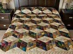 Beautiful tumbling blocks quilt!