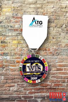 Try a white ribbon and add dashes of color in your medals to really make them stand out in 2020! Check out all of our ribbon options on our website.