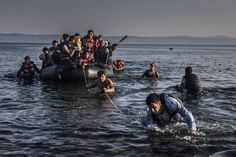 Lesbos, Greece, 27 July 2015 An inflatable dinghy, crowded with refugees and migrants, is pulled ashore on the island of Lesbos after sailing five miles across the Aegean from Turkey. Refugee Boat, Syria Crisis, Refugee Crisis, Syrian Refugees, Twitter Image, Bruges, Greek Islands, Afghanistan, Europe