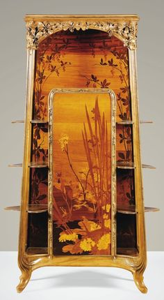 A WALNUT AND FRUITWOOD MARQUETRY ETAGERE CABINET BY LOUIS MAJORELLE, CIRCA 1900, 190cm H.  |  SOLD 49,500 EUR, Paris 2013