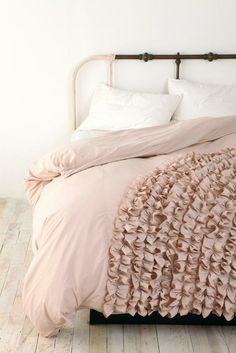 dusty pink ruffled duvet. Two-tone metal bed frame.