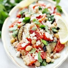 Salad with couscous, eggplant, tomatoes, feta, zatar, red onion,... So tasty! (in Polish)