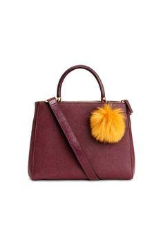 BURGUNDY POM POM HANDBAG Handbag in grained imitation leather with a faux fur pompom, three compartments, two with a zip, a handle and a detachable shoulder strap. Burgundy Handbags, Black Handbags, Purses And Handbags, Tote Purse, Crossbody Bag, Womens Purses, Fashion Handbags, Cross Body Handbags, Shoulder Strap