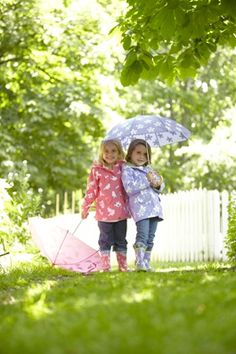 Little girls enjoying out while wearing Hatley Spring Song Raincoat #welliesandworms