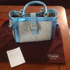 """Coach Ltd Ed Straw Metallic Turnlock Buckle Tote Coach Classic 4419 /Blue Metallic leather and Suede Wicker Handbag .This beautiful bag is the perfect little """"basket"""" bag for spring and summer. It has metal feet and the hardware is goldtone. It is in great pre-owned condition with some very light smudging of dust on top buckle (suede). The handles and leather are in pristine condition. The inside is very clean and has two open pockets and one zipper pocket.! It comes from my clean, smoke…"""