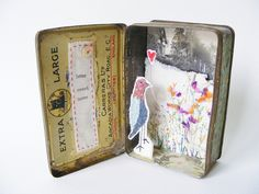 mixed media tin by hens teeth, via Flickr