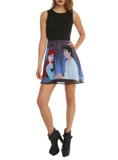 Dress from Disney with a solid black top and The Little Mermaid Ariel and Eric designed skirt. Back zipper closure.