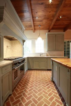 kitchens - rustic wood ceiling brick floor herringbone pattern gray kitchen cabinets marble countertops mosaic marble tiles backsplash gray kitchen island butcher block countertop