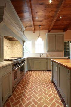 kitchens - rustic wood ceiling brick floor herringbone pattern gray kitchen cabinets marble countertops mosaic marble tiles backsplash gray kitchen island butcher block countertop