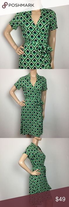 """Banana Republic Silk Blend Geometric Wrap Dress MD MEASUREMENTS: (Please note that the measurements are approximate, and is provided for courtesy only) ALL MEASUREMENTS ARE TAKEN WITH GARMENT LYING FLAT: SLEEVES: 8"""" BUST: 17"""" WAIST: 16"""" LENGHT: 39"""" Banana Republic Dresses"""