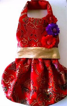 Gold and red brocade dog harness dress,   Flowers are satin with a brocade button in the middle.   Perfect for those party events of Twitter or Instagram photo shoots.   Show them off with a functional, fashionable harness.   Gold d-ring for a leash is triple sewed and the velcro at the neck and chest is industrial strengthfor a secure walk/   Large Neck- 12-14 Chest-14-16 Length-12    Please measure carefully.