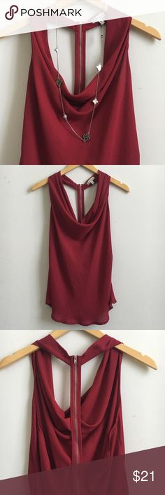 Burgundy Chiffon Halter Top Super cute chiffon halter tank with a cowl heck and exposed back zipper. Perfect with jeans or pants and under a jacket or cardigan.  Shoulder to hem (front): 25inches Bust: 36inches   1) No Trades, Paypal, or other sites 2) Please follow the measurements above or the size guide listing. If you have any questions, always feel free to ask. 3) Everything in my closet is preowned&loved, it's only new if specified Lastly, there is a FREE GIFT with all purchases. HAPPY…