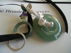 our new enhancers with jade & pearl petals