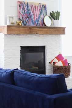 Modern, Rustic Mantel Makeover - Painted stone - shiplap - rough sewn wood mantle - www.simplstylings... - Simple Stylings