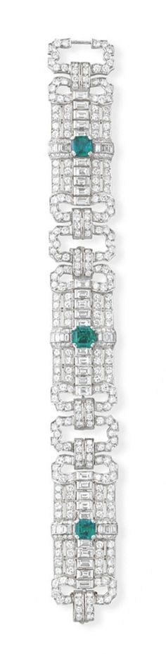AN ART DECO EMERALD AND DIAMOND BRACELET   Designed as three old European and baguette-cut diamond openwork panels, each centering upon a square-cut emerald, joined by old European-cut diamond rectangular links, mounted in platinum, circa 1930, 7 ins.