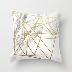 Metallic gold foil geometric shape on a carrara marble backdrop. Throw Pillow made from 100% spun polyester poplin fabric, a stylish statement that will liven up any room. Individually cut and sewn by hand, each pillow features a double-sided print and is finished with a concealed zipper for ease of care.  Sold with or without faux down pillow insert.