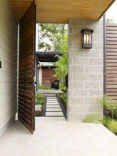 Side Yard path? Like the metal frame + wood gate, lighter stepping blocks on dark gravel, long rectangular planting areas next to path, seating area creates a destination. (Dislike siding & cinderblock materials.)  Cohen Residence, http://www.houzz.com/projects/56464/Cohen-Residence#