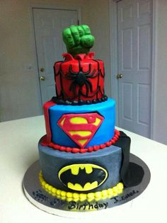 Awesome super hero cake...cuz really who can pick just one?  Maybe switch out Spiderman for Ironman though.