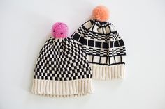 <p>What's black and white and amazing all over? Pretty sure you know the answer. The graphic, black-and-white designs on these cozy, cotton hats are fun without being too out-there, and the bright poms will keep 'em guessing.</p>