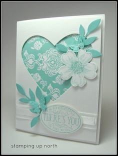 Stampin' Up! ... handmade  card from stamping up north ... monochromatic aqua ... negative space heart backed with patterned paper ... die cut flower and foliage ... butterflies ... beautiful ...