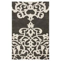 Hand-tufted wool rug with scrollwork motif.  Product: RugConstruction Material: 100% WoolColor: PewterFeatures:  Hand-tuftedMade in India Note: Please be aware that actual colors may vary from those shown on your screen. Accent rugs may also not show the entire pattern that the corresponding area rugs have.Cleaning and Care: These rugs can be spot treated with a mild detergent and water. Professional cleaning is recommended if necessary.
