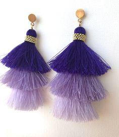 A personal favorite from my Etsy shop https://www.etsy.com/listing/552346065/long-tassel-earrings-purple-ombre-tassel