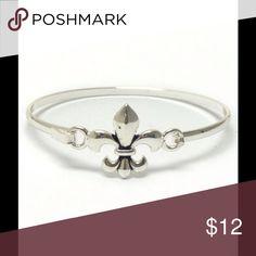 "Fleur De Lis Bangle Fleur de lis metal bangle bracelet -Color: Silver -Size: Fleur 3/4"", 7 3/4"" around (runs on the smaller side) -Non-stretchy -Made of metal alloy (silver and copper and other metal alloy) with high quality plating, Lead and Nickel Compliant. Jewelry Bracelets"