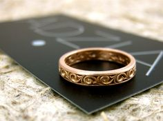 Handmade Wedding Ring in 14K Rose Gold with Scrolls Swirls and Curls with Matte Finish Size 6/3mm. $525.00, via Etsy.