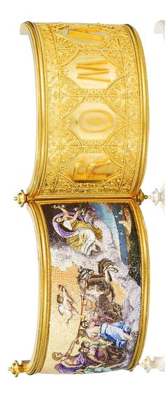 A gold and micromosaic hinged bangle, circa 1870  The wide gold bangle of intricate wirework and beaded decoration, set to the front with a rectangular micromosaic plaque depicting Apollo driving the Carriage of the Sun surrounded by the Hours and preceded by Aurora, 'ROMA' applied to the reverse, inner diameter 5.2cm, fitted case by Cav.L.A Gallandt