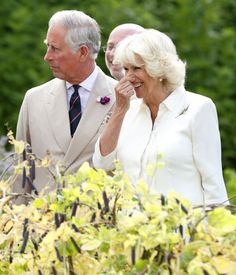 Camilla, Duchess of Cornwall holds her nose as she and Prince Charles, Prince of Wales are given a tour of the vegetable garden by Hugh Fearnley-Whittingstall as they visit River Cottage HQ, Musbury, 15.07.2014 in Axminster, England.