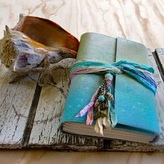 Mermaid Journal...calling all mermaids, channel your inner mermaid with a one of a kind mermaid journal.  Cover is hand painted durable canvas, all covers are cut from the same canvas and will slightly vary.  journal measures: 5 x 7 (closed) paper: 60lb unlined paper pages: 240pp (front/back) tri-fold with sari silk ribbon and mermaid embellishments  Tremundo products are not intended for children. © tremundo All Rights Reserved 2016