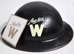 This marking and other variations, were used on British Tommy helmets (and other civil helmets) by the Austin Motor Company in WW2. These would have been worn by Wardens patrolling the factories to ensure 'all lights were out' and to help rescue personnel if the factory was bombed. During the Second World War Austin built cars but also made trucks and aircraft, including the Lancaster bombers of the RAF (Royal Air Force), 617 squadron, better known as the Dambusters.   www.warhats.com