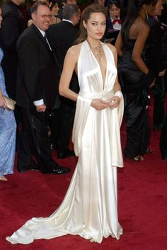 The ethereally beautiful Angelina Jolie wore a plunging white satin gown with matching wrap from Marc Bouwer