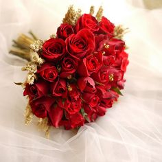 Red wedding bouquet. Definitely don't want one quite so big but I love the touch of gold.