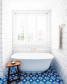 Home Interior Design — Gorgeous blue and white bathroom with tiled floor...