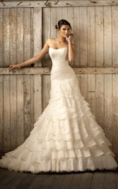 Elegant vintage style wedding dresses feature a scoop neckline and A-line design. Exclusive designer vintage style wedding dresses by Essens...