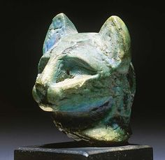 AN EGYPTIAN TURQUOISE GLAZED COMPOSITION HEAD OF A CAT   MIDDLE KINGDOM (2133-1797 B.C.)