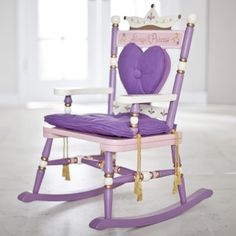 A wonderful chair for the little princess in your life! Full of flourishes this chair's adorable whimsy captures the spirit of make-believe fun. Chinese and furniture-grade hardwoods create a sturdy construction. Purple pink white and gold combine for a majestically appealing color scheme. The soft seat cushion and removable heart shaped back pillow lets her rock in comfort. Support posts and spindles feature painted knobs and fini