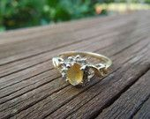 Vintage Gold Ring.  Size 6.5.  10 Karat Yellow Gold with Yellow Stone Surrounded by Tiny Clear Stones