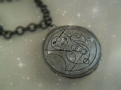 How to make your own Gallifreyan pendant.  You won't believe what this is made of! #DoctorWho #GeekDIY