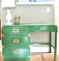 Centsational Girl turned a thrifted campaign desk with compromised wood quality into a total statement piece thanks to kelly green paint. Learn all the steps for re-creating the look.