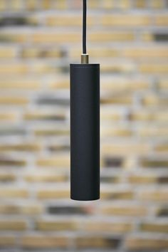Black pendant in powder painted steel with 3 m fabric cord. Brass cable exit.