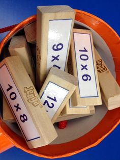 multiplication jenga--could do this with math facts, multiplication, division, etc.    Each block is worth a point, get it wrong, other person gets to answer it, they get it right, they keep it. The person with the most points when the tower falls, is the winner.