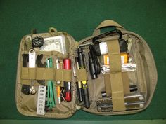 A Maxpedition Fatty EDC pouch with contents