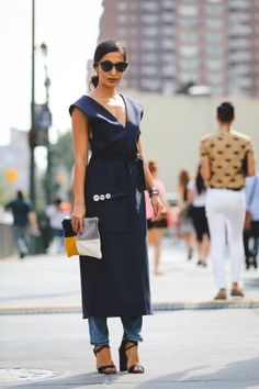 Experiment with style and pair a dress with denim bottoms like this stylish woman  |  For more style inspiration visit 40plusstyle.com