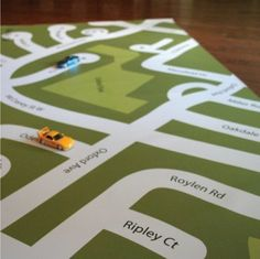 Use local streets and your neighborhood on this custom road map play mat. How much do vinyl sign-makers charge?  The I am Here play mat is custom-designed to your neighborhood and is professionally printed on 10oz vinyl(15oz vinyl is available for an added fee of $8.50). Easy to keep clean and store, the play mat can be wiped with a cloth and rolled up when playtime is over.