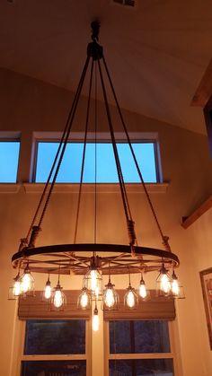 A Wagon Wheel Chandelier – Home Decorating, - beleuchtung Cottage Lighting, Farmhouse Lighting, Rustic Lighting, Cabin Chandelier, Kitchen Chandelier, Wagon Wheel Chandelier Diy, Wagon Wheel Light, Wagon Wheel Decor, Diy Interior