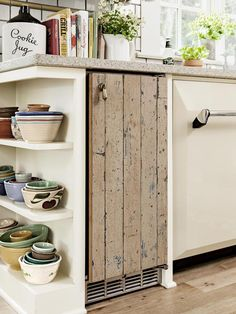 Mask a standard mini fridge with distressed wooden planks for a shabby chic vibe in the kitchen #hgtvmagazine http://www.hgtv.com/kitchens/go-green-with-a-recycled-kitchen/pictures/page-6.html?soc=pinterest