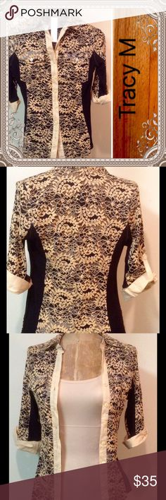 "Gorgeous Lace Top NWT Black cotton and lace top with 3/4 sleeves. Measurements are 25"" long, 14"" armpit to armpit, and 14"" across the shoulders. Spectacular with anything you pair it with. Tracy M Tops Button Down Shirts"